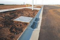 SVC encased and concrete access covers installed roadside.
