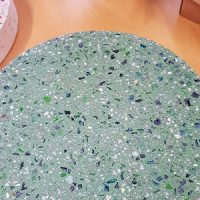 A mixture of blue and green glass fragments bring cool colour into this concrete paver.